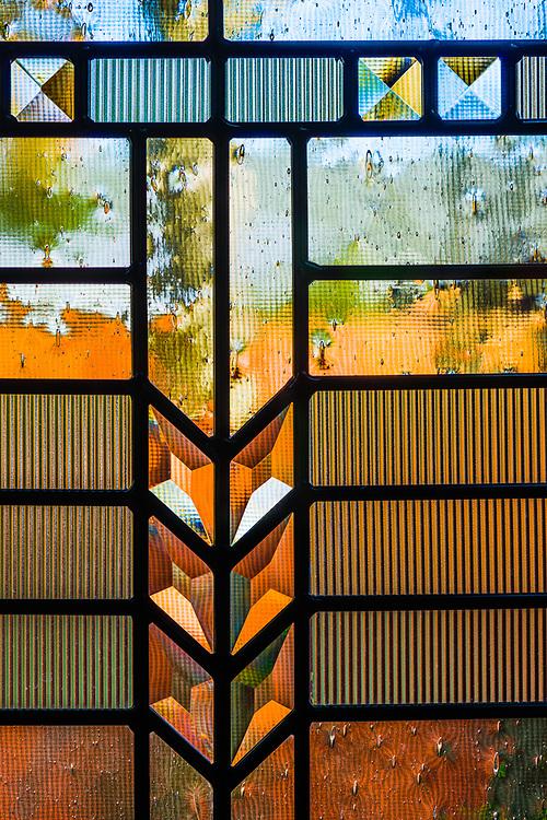 Leaded glass window design, autumn, November, entry door to private residence, Tacoma, Washington, USA