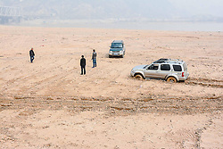 June 1, 2017 - Yuncheng, Yuncheng, China - Yuncheng, CHINA-March 16 2017: (EDITORIAL USE ONLY. CHINA OUT)..A man earns about 1,000 yuan (about US$ 147) every day by dragging cars out of mud by the bank of Yellow River in Yuncheng, northwest China's Shanxi. (Credit Image: © SIPA Asia via ZUMA Wire)