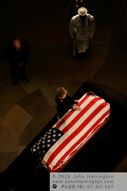 Nancy Reagan visits the casket of her husband and former President of the United States, Ronald Reagan on Wednesday June 9, 2004 inside of Capitol Hill's Rotunda.
