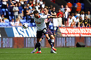 Gary Madine of Bolton Wanderers shields the ball from Richard Keogh of Derby County. Skybet football league championship match, Bolton Wanderers v Derby County at the Macron stadium in Bolton, Lancs on Saturday 8th August 2015.<br /> pic by Chris Stading, Andrew Orchard sports photography.