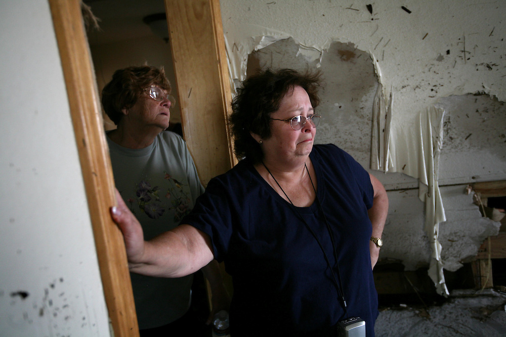 Lifelong Sabine Pass residents Betty Adkins, right, and Lois Berg survey the damage to Betty's home after of Hurricane Ike Friday September 19, 2008.