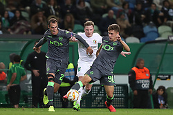 December 13, 2018 - Lisbon, Portugal - Sporting's midfielder Radosav Petrovic from Serbia (L) and midfielder Miguel Luis from Portugal (R ) vies with Vorskla's midfielder Oleksandr Skliar (C ) during the UEFA Europa League Group E football match Sporting CP vs FC Vorskla Poltava at Alvalade stadium in Lisbon, Portugal on December 13, 2018 (Credit Image: © Pedro Fiuza/ZUMA Wire)