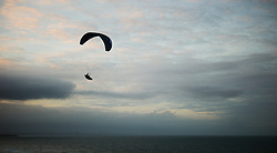 © Licensed to London News Pictures.18/10/15<br /> Saltburn, UK. <br /> <br /> A paraglider flies using the northerly onshore wind blowing off the north sea to rise above the cliff face at Saltburn by the Sea.<br /> <br /> Photo credit : Ian Forsyth/LNP