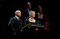 Presenters Edie Falco and Paul Schulze on stage at the 37th International Emmy Awards Gala in New York on Monday, November 23, 2009.  ***EXCLUSIVE***