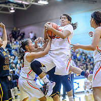 Gallup Bengal Leona Smith (33) secures a rebound after a Tohatchi Cougar missed shot during the John Lomasney Invitational basketball tournament at Gallup High School Friday.