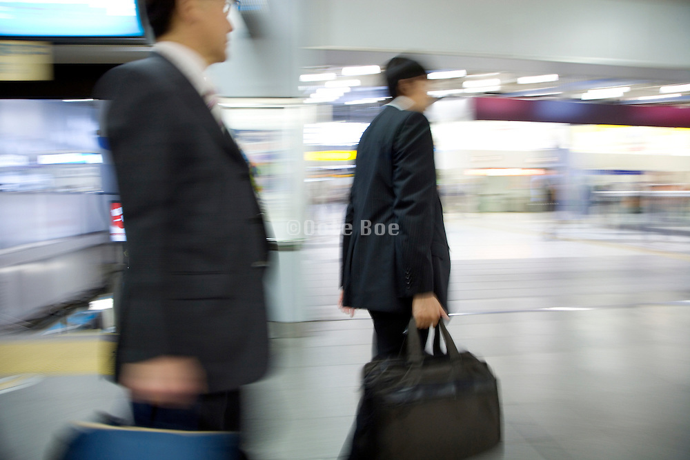 businessmen hurrying on their way to work