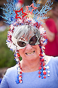 A woman dressed in patriotic costume stands in the I'On Community 4th of July parade.