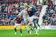 Joe Lewis (#1) of Aberdeen FC punches clear of Steven MacLean (#18) of Heart of Midlothian during the Ladbrokes Scottish Premiership match between Heart of Midlothian and Aberdeen at Tynecastle Stadium, Edinburgh, Scotland on 20 October 2018.