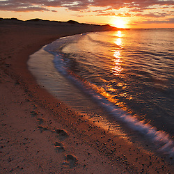 The sun sets over Head of the Meadow Beach, Cape Cod National Seashore, Truro, Massachusetts.