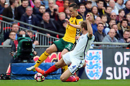 Eric Dier of England slide tackling Egidijus Vaitkunas of Lithuania during the FIFA World Cup Qualifier group stage match between England and Lithuania at Wembley Stadium, London, England on 26 March 2017. Photo by Matthew Redman.