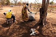 Regina Ejango Festo, 49, casts her vote in a polling station in Toko-ko Tului town some 60 miles northwest oj Juba during the South Sudan referendum. (PHOTO: MIGUEL JUAREZ LUGO).