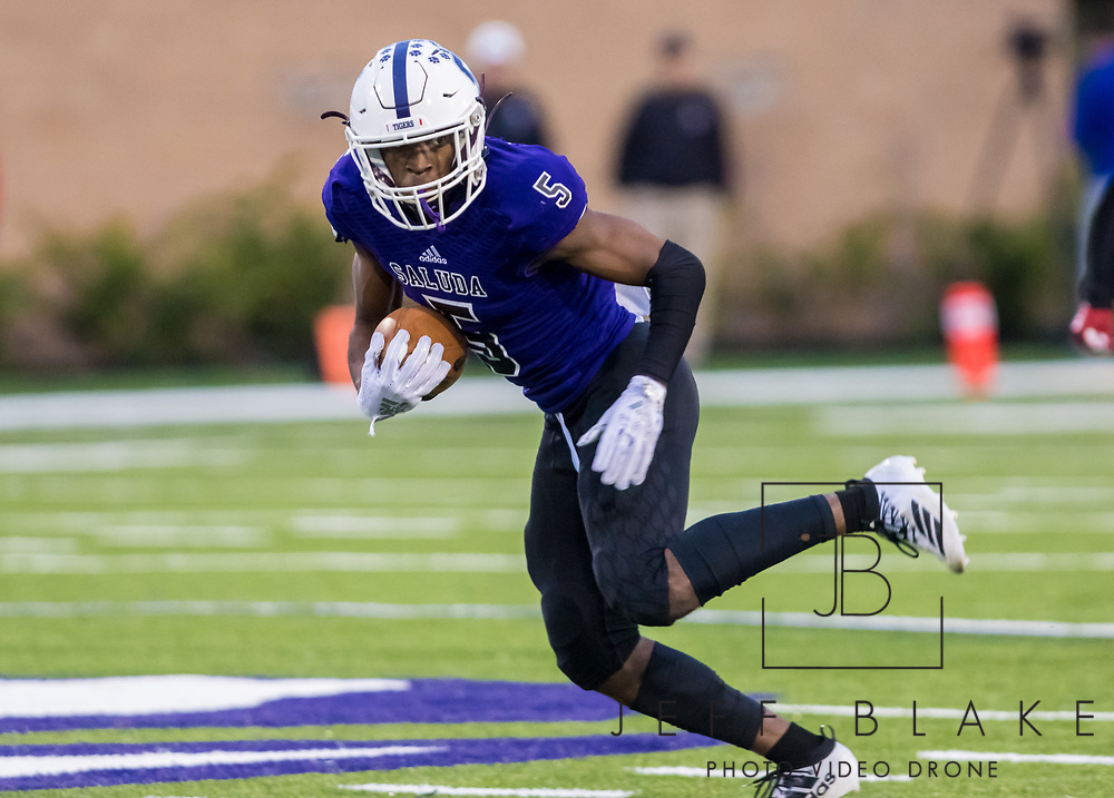Saluda Tigers WR Jervon Whitt (5) makes a gain after the reception against the Barnwell Warhorses in the Class AA State Championship game. 2019 Saluda State Championship Football Photos