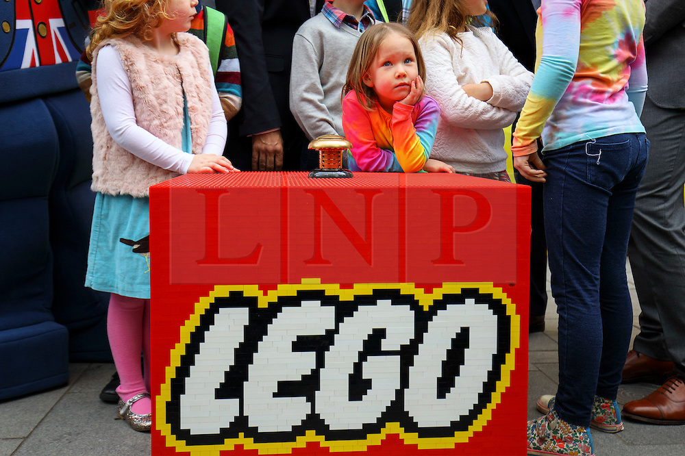 © Licensed to London News Pictures. 17/11/2016. London, UK. A child waits the world's largest Lego Store to be opened in Leicester Square, London on 17 November 2016. Photo credit: Tolga Akmen/LNP