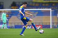 AFC Wimbledon midfielder George Dobson (24) dribbling during the EFL Sky Bet League 1 match between AFC Wimbledon and Milton Keynes Dons at Plough Lane, London, United Kingdom on 30 January 2021.