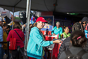 AARP's Kristin Walus greets visitors at the AARP Block Party at the Albuquerque International Balloon Fiesta in Albuquerque New Mexico USA on Oct. 7th, 2018.