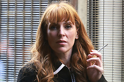 © Licensed to London News Pictures. 26/09/2021. Brighton, UK. Deputy leader ANGELA RAYNER smokes a cigarette inside security gates at the conference . The second day of the 2021 Labour Party Conference , which is taking place at the Brighton Centre . Photo credit: Joel Goodman/LNP