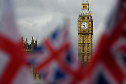 © Licensed to London News Pictures. 24/06/2016. London, UK. St Georges flag and the Union flag wave in front of The House of Parliament in Westminster, London on the day that the UK voted to leave the EU in a referendum. Photo credit: Ben Cawthra/LNP