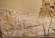 Chariot with wheel depicted in a stomne relief from Nimrud (ancient Kalhu), northern Iraq. Neo-Assyrian, about 730-727 BC