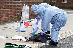 © Licensed to London News Pictures. 31/03/2019. London, UK. Forensic Officers collects the victim's belongings on Fore Street in Edmonton, north London where a person was stabbed just after 9.30am this morning. The victim was taken to a hospital by Air Ambulance and his condition is unknown. Photo credit: Dinendra Haria/LNP