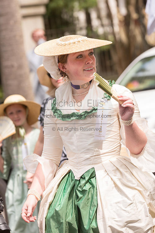 Women dressed in period costume march down Meeting Street to celebrate Carolina Day June 28, 2014 in Charleston, SC. Carolina Day celebrates the 238th anniversary of the American victory at the Battle of Sullivan's Island over the Royal Navy and the British Army.