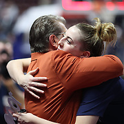 UNCASVILLE, CONNECTICUT- DECEMBER 19:  Head coach Geno Auriemma of the UConn Huskies is embraced by Katie Lou Samuelson #33 of the Connecticut Huskies after ecording his 1000th win as head coach of the team during the Naismith Basketball Hall of Fame Holiday Showcase game between the UConn Huskies Vs Oklahoma Sooners, NCAA Women's Basketball game at the Mohegan Sun Arena, Uncasville, Connecticut. December 19, 2017 (Photo by Tim Clayton/Corbis via Getty Images)