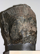 Head from an Egyptian royal statue. 18th Dynasty (approx. 1420 BC) from the Temple of Karnak in Thebes. Dated mid to late 18th Dynasty (approx. 1420 BC). Made of Granodiorite.