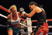 pvc061011b/6-10-11/sports.  Holly Holm battles Victoria Cisneros Friday night at Route 66 Casino Hotel June 10, 2011.  (Pat Vasquez-Cunningham/Journal)