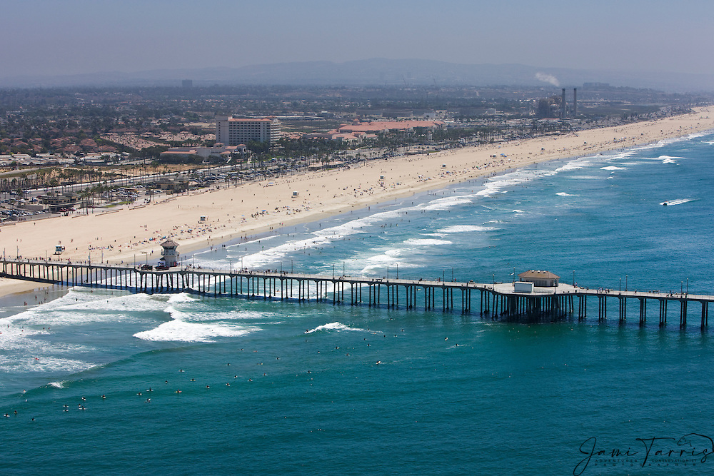 An aerial view of downtown Huntington Beach, the Pier and the Pacific Ocean in front of Saddleback Mountain,Huntington Beach,California,USA