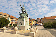 Dobo Statue with Eger Castle behind - Hungary