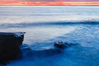 The aptly named Sunset Cliffs in San Diego, California is one of the best places to watch the sun go down as waves crash on the rocks below. A long exposure smooths out the sea and begins to look more like clouds over a craggy mountain peak