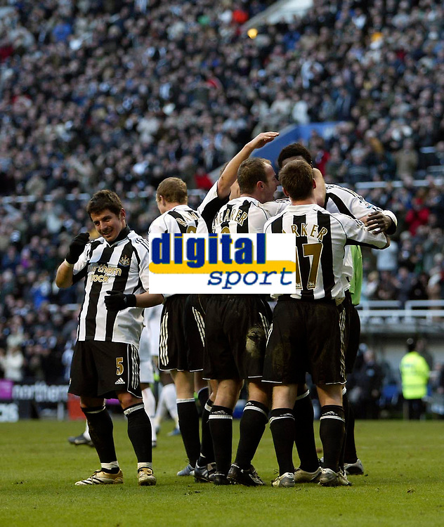 Photo: Andrew Unwin.<br />Newcastle United v Bolton Wanderers. The Barclays Premiership. 04/03/2006.<br />Newcastle celebrate their third goal, scored by Shola Ameobi.