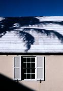 Palm tree shadow on Caribbean house.