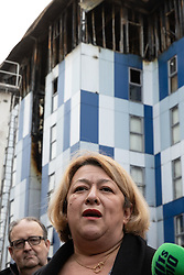 """© Licensed to London News Pictures. 16/11/2019. Bolton, UK. DAVID GREENHALGH of Bolton Council and SANDRA RUIZ of Grenfell United at a press conference at the site of the blaze . Firefighters work at the scene where a fire broke out overnight (15th/16th November 2019) at a block of flats known as """" The Cube """" , in Bolton Town Centre . At least two people are known to have been treated by paramedics at the scene of the six-story block , which is occupied by students of the University of Bolton . Photo credit: Joel Goodman/LNP"""