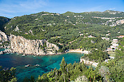 Paleokastritsa beach resort - blue sky, cliffs and turquoise Ionian Sea in Corfu, Ionian Islands, Greece
