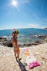THEMENBILD - URLAUB IN KROATIEN, eine junge Frau genießt die Sonne und macht sich zum Schnorcheln bereit, aufgenommen am 03.07.2014 in Vrsar, Kroatien // a young woman enjoying the sun and makes itself ready for snorkeling near Vrsar, Croatia on 2014/07/03. EXPA Pictures © 2014, PhotoCredit: EXPA/ JFK