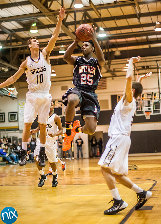Northwest Cabarrus' Anthony Caldwell goes up for a shot against Concord Tuesday night at Concord High School. Concord won the game 89-49.