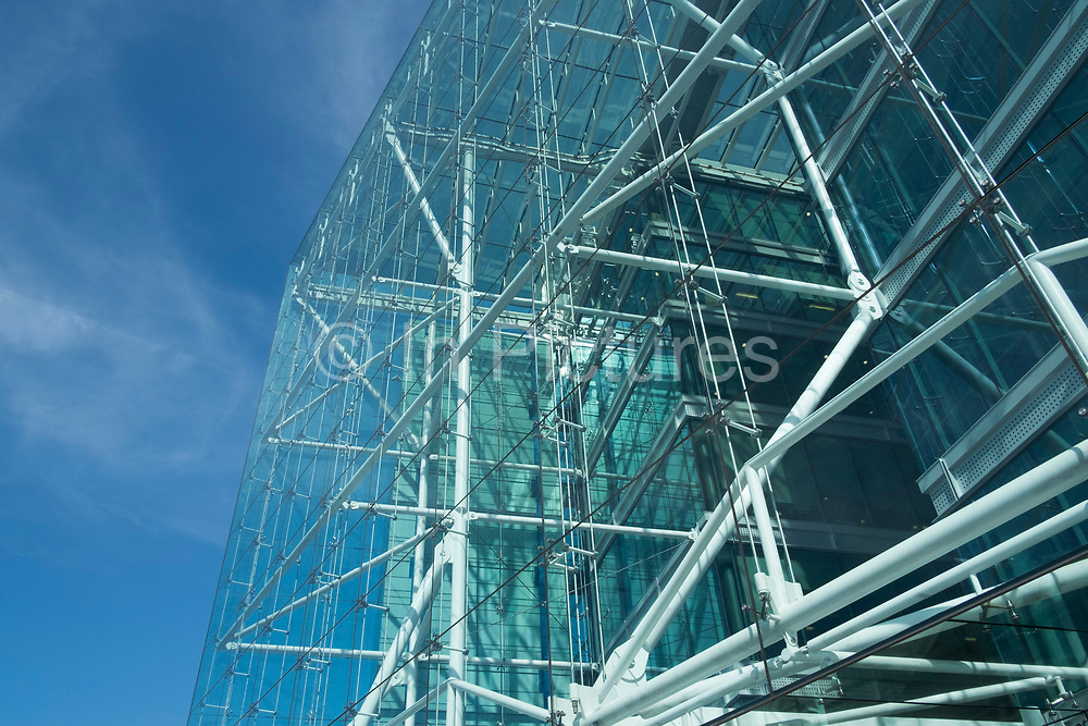 Glass structure of a building utilising modern architecture reflecting the sky in London, England, United Kingdom. The large transparent facade allows light to fill the interior. (photo by Mike Kemp/In Pictures via Getty Images)