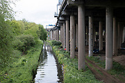 River Tame runs alongside Gravelly Hill Interchange, aka Spaghetti Junction which is virtually deserted under Coronavirus lockdown, while far fewer vehicles pass overhead on 29th April 2020 in Birmingham, England, United Kingdom. The term Spaghetti Junction was originally used to refer to Gravelly Hill Interchange on the M6 motorway in an article published in the Birmingham Evening Mail on 1 June 1965 the journalist Roy Smith described plans for the junction as like a cross between a plate of spaghetti and an unsuccessful attempt at a Staffordshire knot. Coronavirus or Covid-19 is a new respiratory illness that has not previously been seen in humans. While much or Europe has been placed into lockdown, the UK government has put in place more stringent rules as part of their long term strategy, and in particular social distancing.