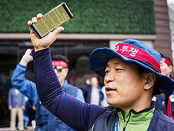 October 9, 2018 - Seoul, Gyeonggi, South Korea - A Samsung worker leads workers in a chant during a protest by Samsung union members. Hundreds of Samsung workers marched through central Seoul Tuesday to draw attention to the company's labor issues, which includes punishing workers for joinging unions, retaliating against labor organizers and profiling potential ''troublemakers'' who are thought likely to organize. Samsung has also started layoffing workers, especially younger ones, as company profits have decreased. Layoffs in South Korea have been relatively rare, many workers thought a job with Samsung and other South Korean industrial giants was a job for life. (Credit Image: © Jack Kurtz/ZUMA Wire)