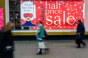 People walk past a branch of Debenhams that is displaying half price winter sale signs in Oxford Street, London, UK on January 03, 2019