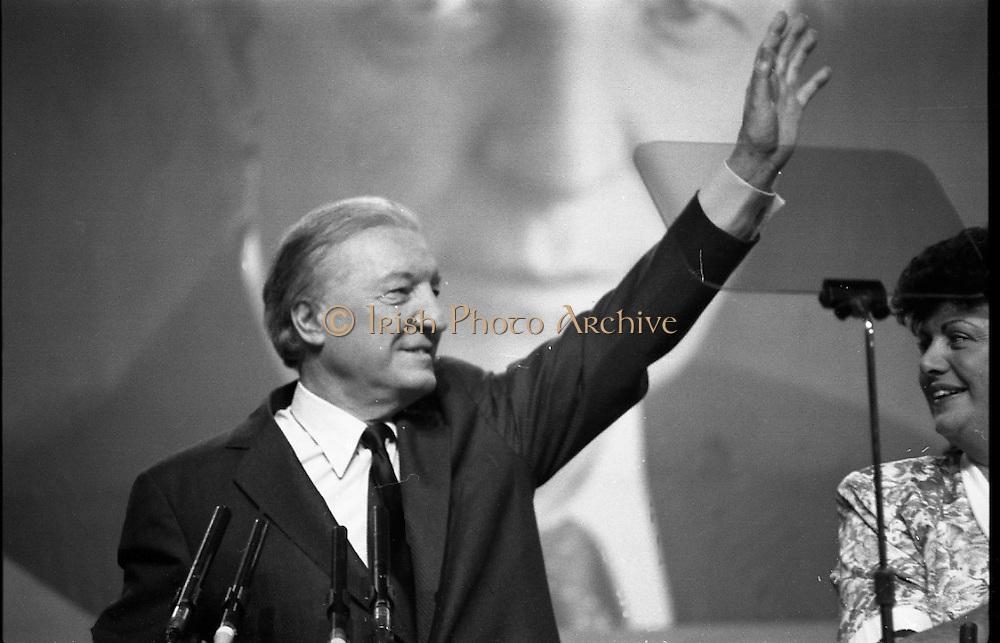 Fianna Fáil Ard Fheis.  (R97)..1989..25.02.1989..02.25.1989..25th February 1989..The Fianna Fáil Ard Fheis was held today at the RDS Main Hall, Ballsbridge, Dublin. An Taoiseach, Charles Haughey TD,gave the keynote speech of the event...An Taoiseach, Charles Haughey TD, is pictured as he takes place at the podium, he is accompanied by  Minister Máire Geoghegan-Quinn