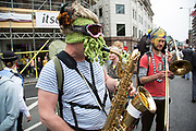 London, UK. Saturday 20th June 2015. People's Assembly against austerity demonstration through Central London. 250,000 people gathered to protest in a march through the capital protesting against the Tory cuts, holding placards and banners. Band playing take a ride on a police van.