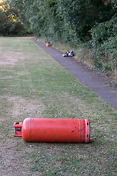 © Licensed to London News Pictures. 28/06/2018. Fetcham, UK.  Dumped rubbish and gas cylinders left behind after travellers left Fetcham Recreation ground. The site was occupied by 18 vehicles on Wednesday 27th June and the occupants were issued with a Notice of Direction requesting that they leave by Mole Valley District Council. This has been ignored and the council went to court to seek further legal action yesterday (28th June 2018). Photo credit: London News Pictures