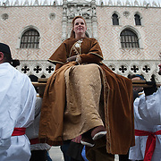 VENICE, ITALY - FEBRUARY 11:  The traditional parade of '12 beautiful Venetian girls' forms part of the Festa delle Marie in St Mark's Square on February 11, 2012 in Venice, Italy.The annual festival, which lasts nearly three weeks, will see the streets and canals of Venice filled with people wearing highly-