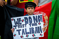 © Licensed to London News Pictures. 18/08/2021. LONDON, UK.  A young member of the British Afghan community protests in Parliament Square in reaction to the Taliban takeover of Afghanistan.  Parliament has been recalled early for Boris Johnson, Prime Minister, and MPs to debate the UK government's decision to bring 20,000 vulnerable Afghan refugees, particularly women and children, to the country..  Photo credit: Stephen Chung/LNP