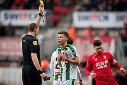 (L-R) referee Ed Janssen, Ajdin Hrustic of FC Groningen during the Dutch Eredivisie match between FC Twente Enschede and FC Groningen at the Grolsch Veste on March 04, 2018 in Enschede, The Netherlands