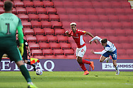 Charlton Athletic attacker Lyle Taylor (9) on his way and passing the ball for Rochdale attacker Calvin Andrew (9) to score own goal during the EFL Sky Bet League 1 match between Charlton Athletic and Rochdale at The Valley, London, England on 4 May 2019.