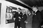 """05/04/1963<br /> 04/05/1963<br /> 05 April 1963<br /> Opening of """"Ulster Today"""" architectural photographic exhibition.Organised by the Royal Society of Ulster Architects opened at the Gallery of the Building Centre of Ireland  in Dublin in the presence of Donagh O'Malley, Parlimentary Secretary to the Minister for Finance and Sir Ian MacLennan, British Ambassador to Ireland. The exhibition was later displayed in Belfast. Picture shows: President of the Royal Society of Ulster Architects, Charles Munro ARIBA, (second from left) showing Donagh O'Malley (left) round the exhibition after the opening. Also in the picture are Dr. R.B. McDowell, (second from right) Trinity College, Dublin who opened the exhibition and Don MacGreevy, Managing Director of the Building Centre of Ireland."""