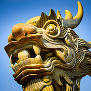 Head of a dragon statue at the Imperial City in Hue, Vietnam. A self-enclosed and fortified palace, the complex includes the Purple Forbidden City, which was the inner sanctum of the imperial household, as well as temples, courtyards, gardens, and other buildings. Much of the Imperial City was damaged or destroyed during the Vietnam War. It is now designated as a UNESCO World Heritage site.
