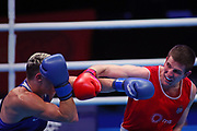 Milan Vrankovic of Serbia (red) and Hugo Micallef of Monaco (bue) competing in the Men's Welterweight preliminaries during The Road to Tokyo European Olympic Boxing Qualification, Sunday, March 15, 2020, in London, United Kingdom. (Mitchell Gunn-ESPA-Images/Image of Sport)